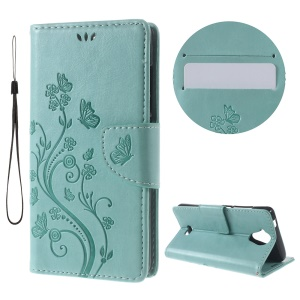 Imprint Butterfly Flower Leather Case with Stand for Wiko U Feel Lite - Cyan